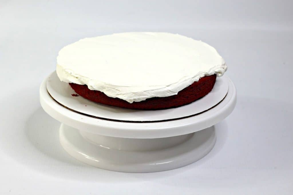 one layer of cake with frosting