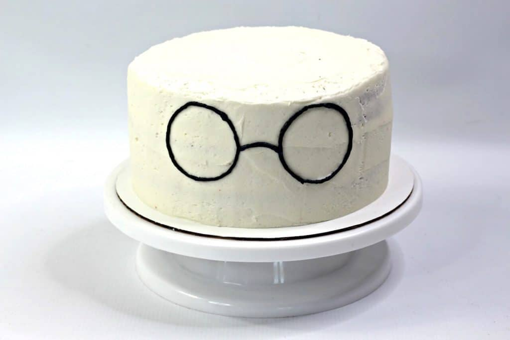 cake with piped iced glasses