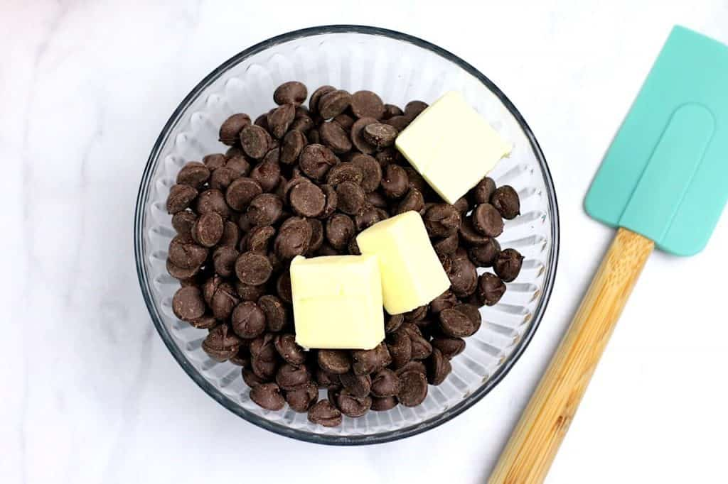 butter on top of chocolate chips in bowl