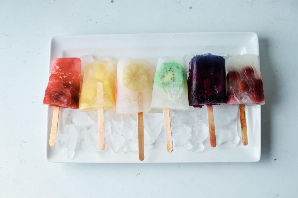 Rainbow popsicles on a plate of ice