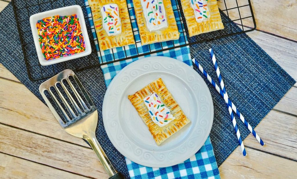 pop tart on plate with frosting and sprinkles