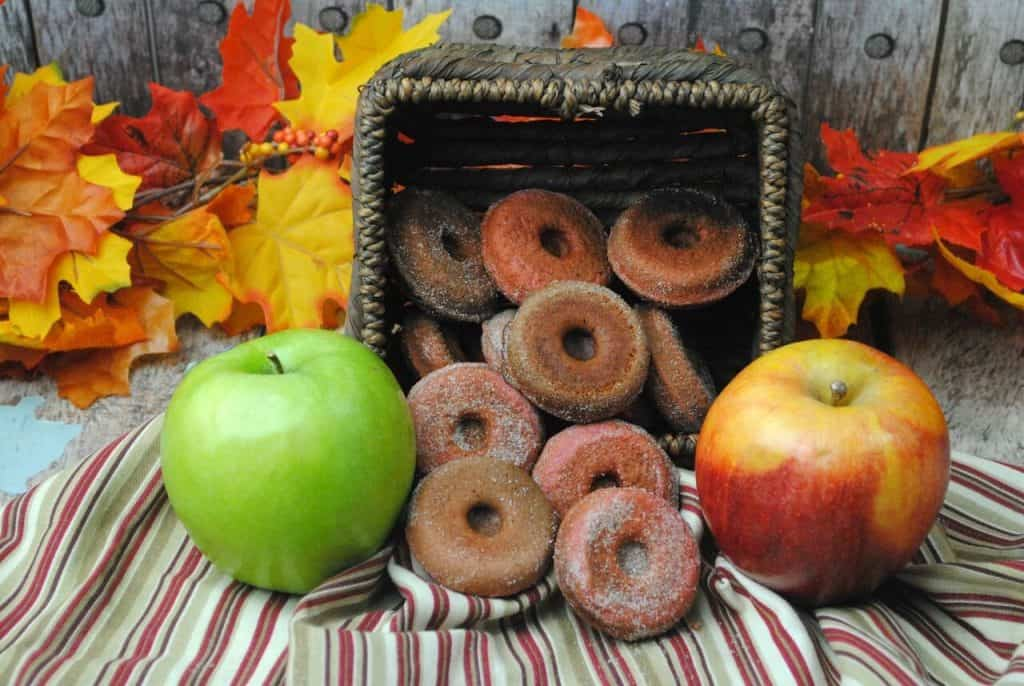 donuts falling out of basket next to apples