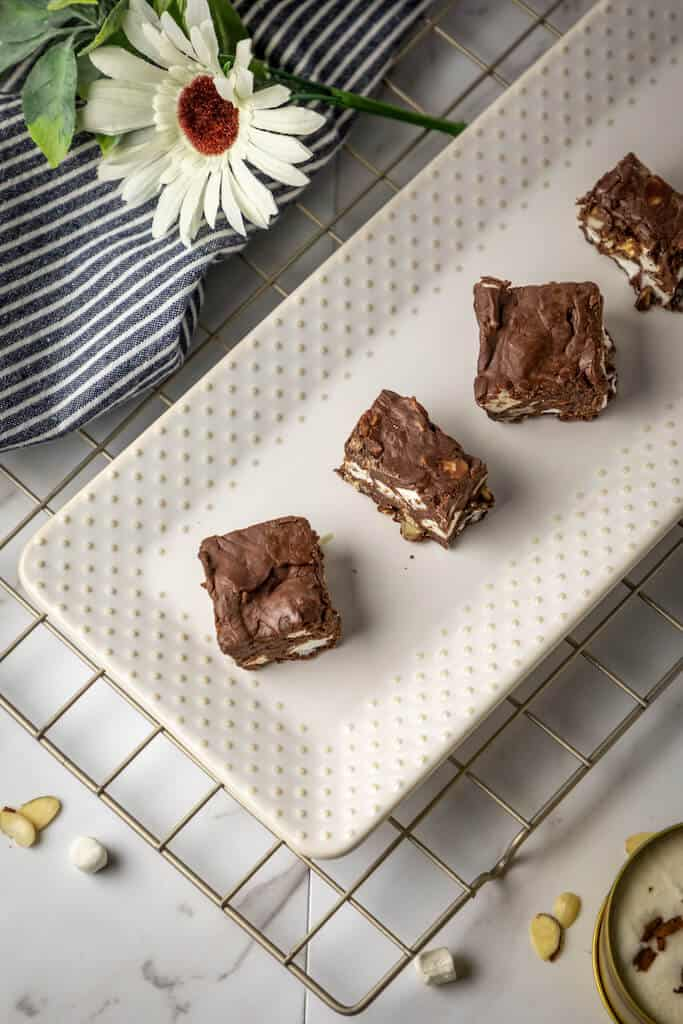 pieces of chocolate rocky road fudge on a plate