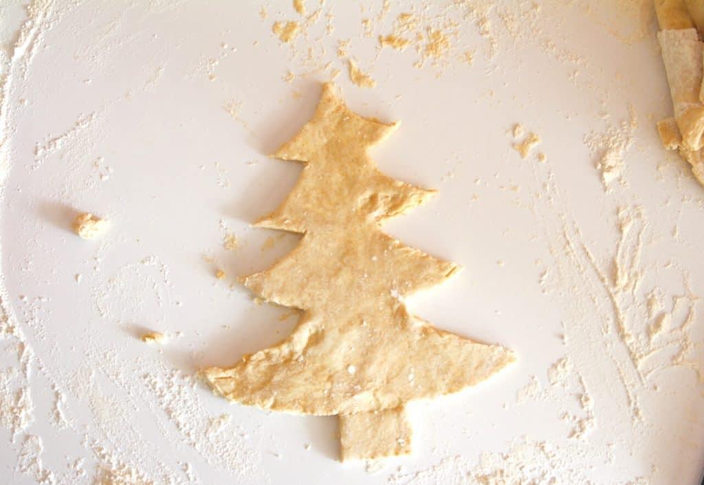Pie crust dough cut like a Christmas tree
