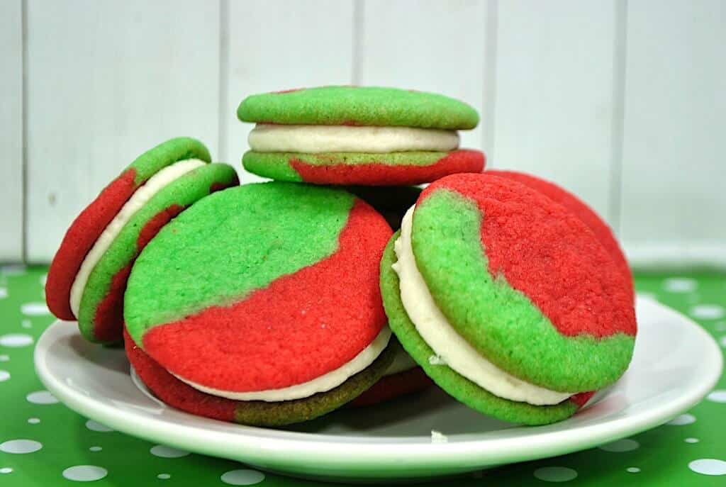 cookie sandwiches with red and green cookie and white frosting