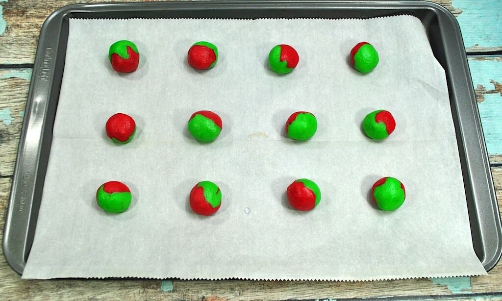 baking sheet with red and green dough balls