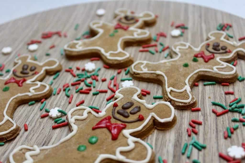 gingerbread men shaped like Mickey Mouse on a cutting board