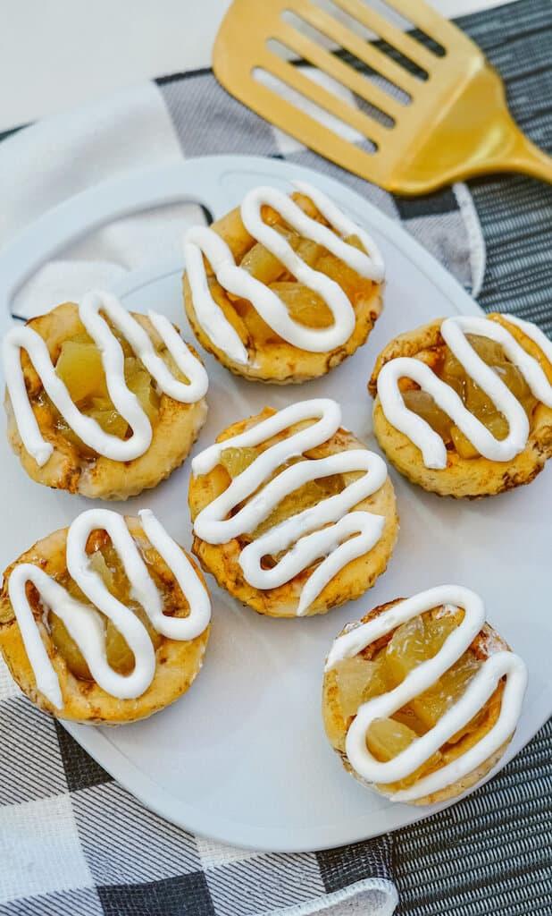 6 mini apple pie cups on a plate
