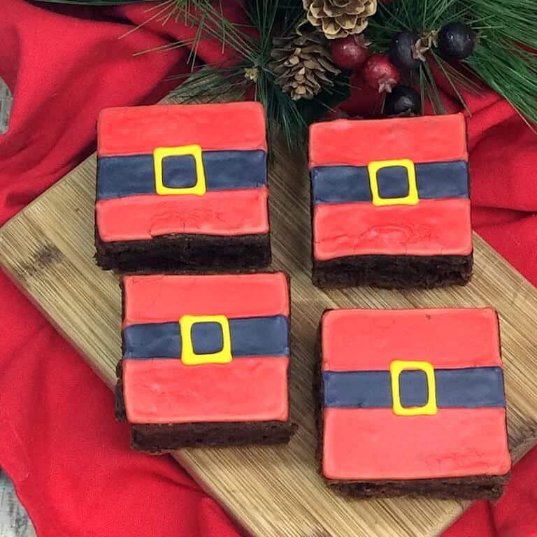 Santa Belt Brownies on a cutting board