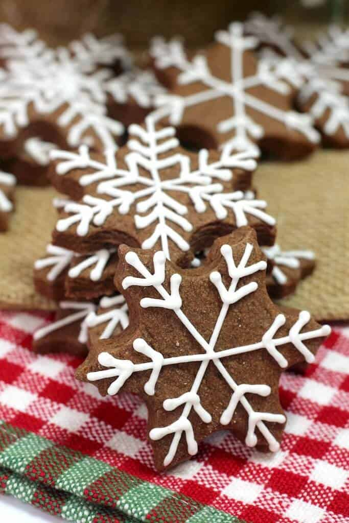 Brownie Snowflake Sugar Cookies with white frosting