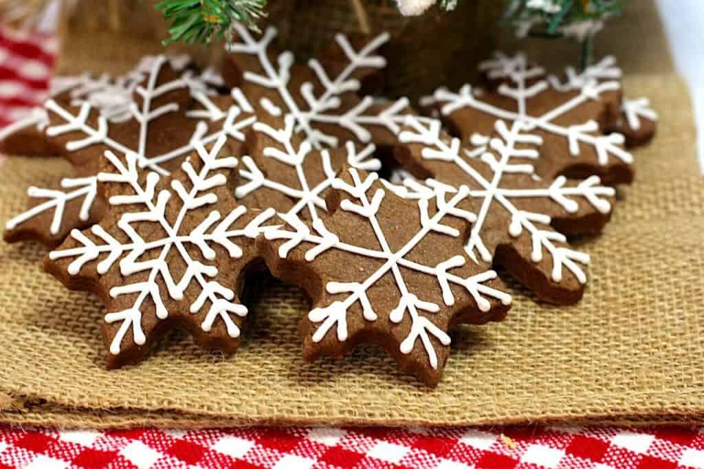 chocolate snowflake cookies with white frosting