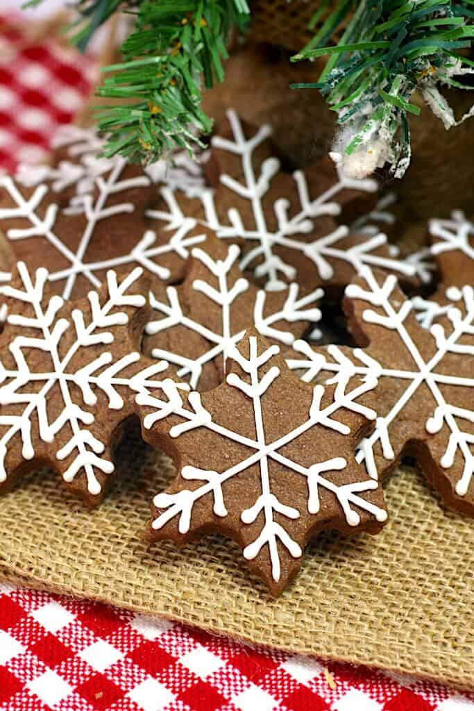 pile of chocolate cookies shaped like snowflakes