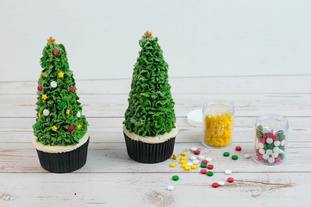 decorating the ice cream cone Christmas tree with sprinkles