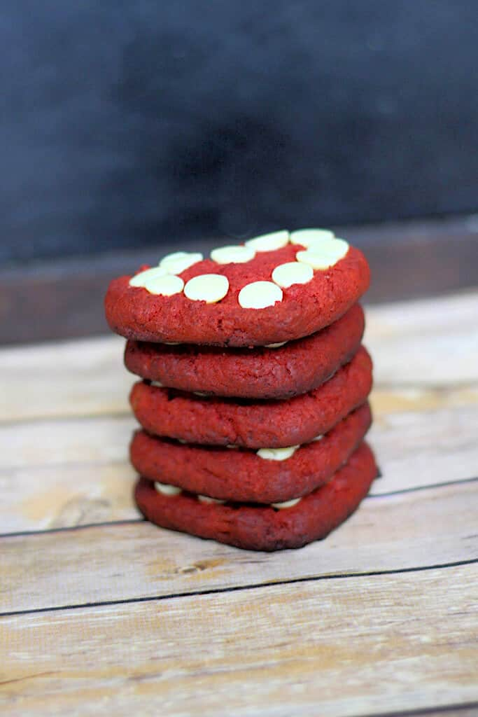 Stack of red heart cookies with white chocolate chips in the middle